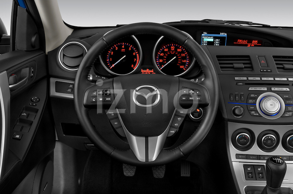 Steering wheel view of a 2010 Mazda 3 5-Door S Grand Touring