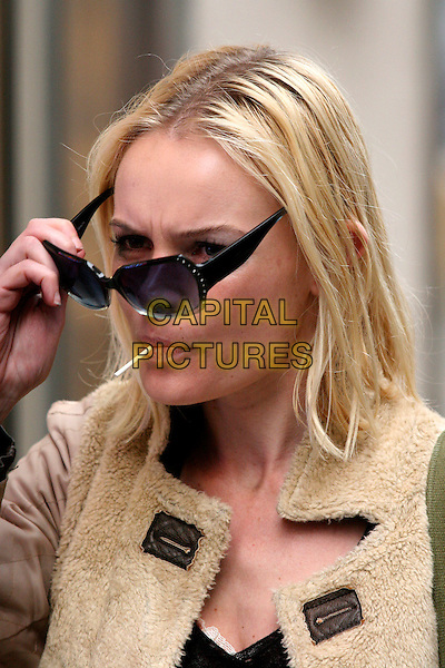 "KATE BOSWORTH.On the film set for "" A Girl In The Park"", New York, NY, USA..November 29th, 2006.headshot portrait lollypop in mouth eating lollipop candy  black dark sunglasses diamante sides beige sheepskin jacket .CAP/IW.©Ian Wilson/Capital Pictures"