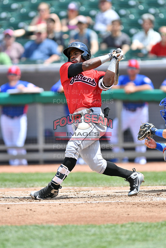 Birmingham Barons center fielder Tito Polo (18) swings at a pitch during a game against the Tennessee Smokies at Smokies Stadium on May 6, 2018 in Kodak, Tennessee. The Smokies defeated the Barons 6-2. (Tony Farlow/Four Seam Images)