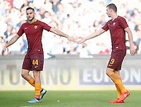 Calcio, Serie A: Napoli vs Roma. Napoli, stadio San Paolo, 15 ottobre. <br /> Roma&rsquo;s Edin Dzeko, right, is congratulated by teammate Kostas Manolas after scoring his second goal during the Italian Serie A football match between Napoli and Roma at Naples' San Paolo stadium, 15 October 2016. Roma won 3-1.<br /> UPDATE IMAGES PRESS/Isabella Bonotto