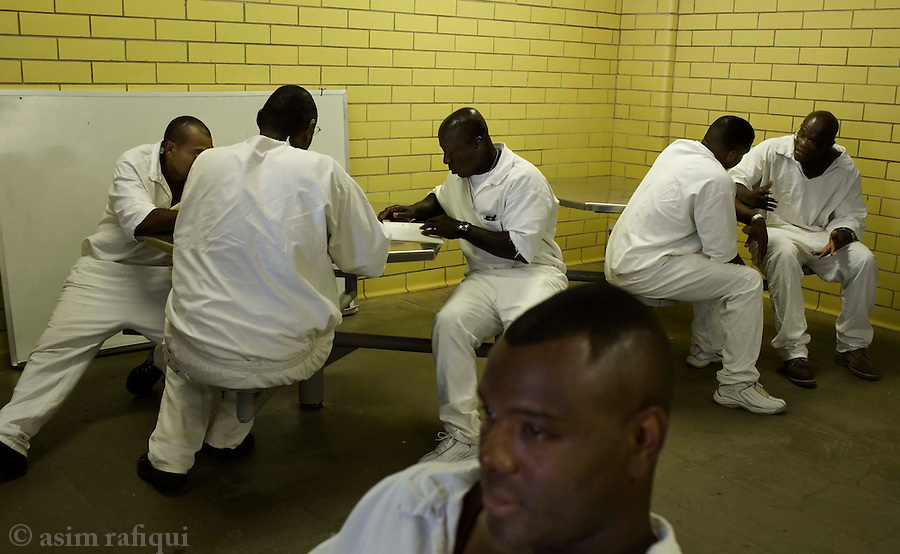 Inmates during a bible study session<br />