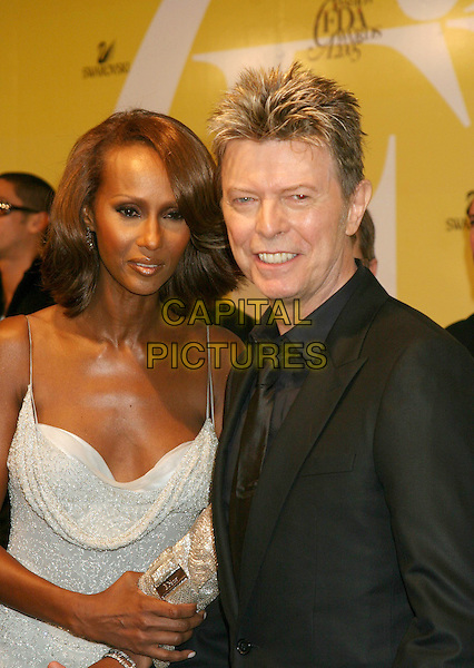 IMAN & DAVID BOWIE.2005 CFDA Fashion Awards - Inside Arrivals.New York Public Library in New York City, New York, USA, June 6th 2005 .half length married husband wife.Ref: IW.www.capitalpictures.com.sales@capitalpictures.com.©Ian Wilson/Capital Pictures.