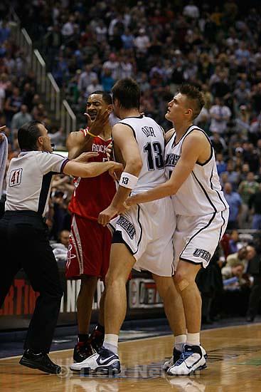 Salt Lake City - Utah Jazz center Mehmet Okur (13), of Turkey, is restrained by Utah Jazz forward Andrei Kirilenko (47), of Russia, after Okur was fouled by Houston's Juwan Howard. Utah Jazz vs. Houston Rockets, game 6, NBA playoffs first round.