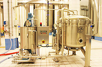 In the winery: In the winery: a Filtrox kieselguhr (diatomite) filter in stainless steel in the main blending hall with big wine vats for fermentation or blending in the background, the Union Champagne cooperative, also called Champagne de Saint Gall in Avize, Cote des Blancs, Champagne, Marne, Ardennes, France