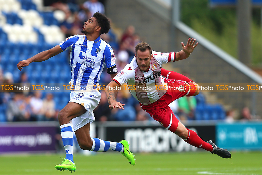 Mikael Mandron of Colchester United collides with Luke Wilkinson of Stevenage during Colchester United vs Stevenage, Sky Bet EFL League 2 Football at the Weston Homes Community Stadium on 12th August 2017