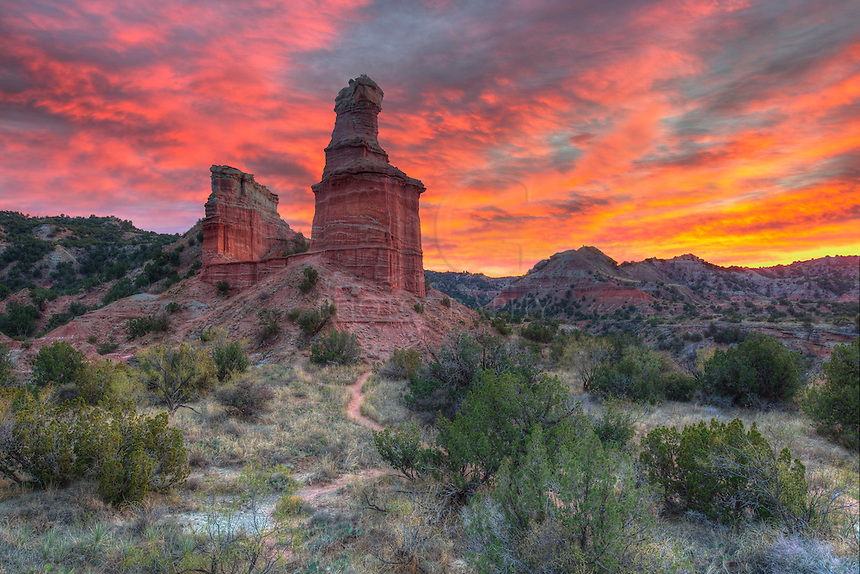 I had almost given up on having a good sunset when suddenly the orange and pink light began to creep across these low clouds at Palo Duro Canyon's iconic monument - the Lighthouse.