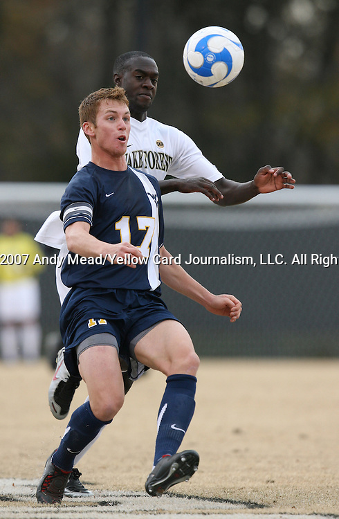 02 December 2007: West Virginia's Andrew Halsell (17) defends against Wake Forest's Marcus Tracy (behind). The Wake Forest University Demon Deacons defeated the West Virginia University Mountaineers 3-1 at W. Dennie Spry Soccer Stadium in Winston-Salem, North Carolina in a Third Round NCAA Division I Mens Soccer Tournament game.