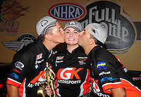 Jul. 1, 2012; Joliet, IL, USA: NHRA pro stock driver Erica Enders (center)is kissed by crew chief Dave Connolly (left) and boyfriend Richie Stevens Jr after winning her first career race at the Route 66 Nationals at Route 66 Raceway. Mandatory Credit: Mark J. Rebilas-
