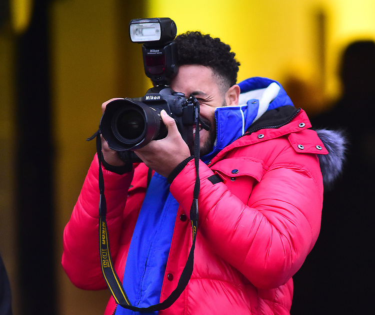 Lincoln City's Bruno Andrade taking photographs during the pre-match warm-up<br /> <br /> Photographer Andrew Vaughan/CameraSport<br /> <br /> The EFL Sky Bet League Two - Saturday 15th December 2018 - Lincoln City v Morecambe - Sincil Bank - Lincoln<br /> <br /> World Copyright © 2018 CameraSport. All rights reserved. 43 Linden Ave. Countesthorpe. Leicester. England. LE8 5PG - Tel: +44 (0) 116 277 4147 - admin@camerasport.com - www.camerasport.com