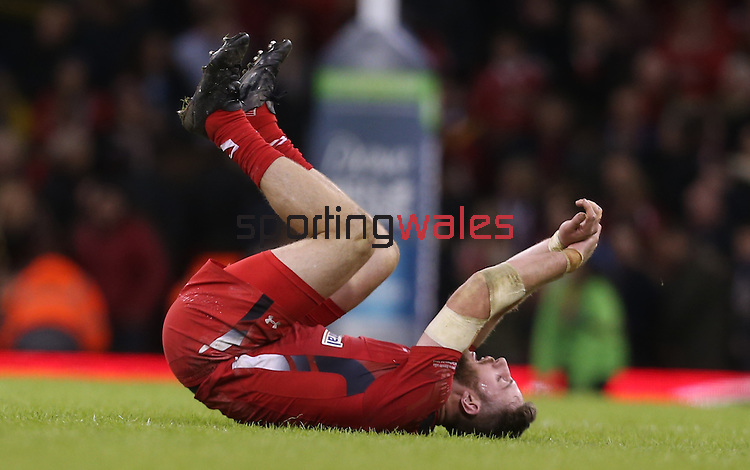 Down and out, a dejected Alex Cuthbert drops to the floor at the final whistle after Wales lose to Australia.<br /> Dove Men Series 2014<br /> Wales v Australia<br /> Millennium Stadium<br /> 08.11.14<br /> ©Steve Pope-SPORTINGWALES