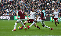 Burnley's Ashley Barnes gets in between West Ham United's Angelo Ogbonna and Aaron Cresswell<br /> <br /> Photographer Rob Newell/CameraSport<br /> <br /> The Premier League - West Ham United v Burnley - Saturday 10th March 2018 - London Stadium - London<br /> <br /> World Copyright &copy; 2018 CameraSport. All rights reserved. 43 Linden Ave. Countesthorpe. Leicester. England. LE8 5PG - Tel: +44 (0) 116 277 4147 - admin@camerasport.com - www.camerasport.com