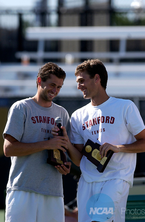 31 MAY 2004:  KC Corkery (left) and Sam Warburg of Stanford pose with their trophies after defeating Bo Hodge and John Isner of Georgia during the 2004 NCAA Division I Men's Tennis Championships hosted by the University of Tulsa and held at the Michael D. Case Tennis Center in Tulsa, OK.  Warburg and Corkery defeated Hodge and Isner 6-2, 6-7 (3), 6-4 for the doubles title. Stephen Pingry/NCAA Photos