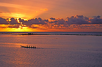 Guam sunset with paddlers in the foreground, Tumon Bay