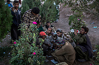 HERAT, AFGHANISTAN - OCTOBER 05, 2013, 2013: Afghan man smokes smoke opium in a public garden in the centre of the city.  <br /> <br /> CREDIT: Daniel Berehulak for the New York Times