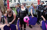 Protesters with helmets and shields stood outside a memorial for Heather Heyer Wed., August 16, 2017, at the Paramount Theater in Charlottesville, Va. Heyer was killed the previous weekend when a vehicle drove into a crowd of counter-protestors after the Unite The Right rally. Photo/Andrew Shurtleff