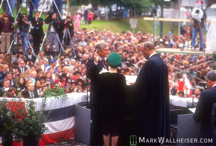While his wife, Rhea Chiles (center) holds the bible, Lawton Chiles (L)  is sworn in by Florida Chief Justice Leander. Shaw as Florida's 41st Governor on January 8, 1991 on the front steps of the Florida Capitol in Tallahassee, Florida.