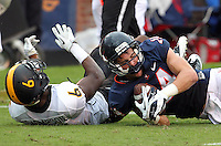 Virginia Cavaliers wide receiver Matt Snyder (14) makes a catch in front of Southern Miss Golden Eagles defensive back Martez Thompson (6) during the game at Scott Stadium. Virginia was defeated 30-24. (Photo/Andrew Shurtleff)