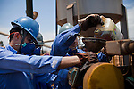 ITUMBIARA, BRAZIL - OCTOBER 16:<br /> Workers add oil to a water filtration system that will clean water waste and return to the facility to use, at one of Cargill's plants near the city of Itumbiara, in Goias state, Brazil, on Wednesday, Oct. 16, 2013. Since the US recently passed a number of regulations and standards for cars and dropped tariffs that were in place for decades against Brazilian sugar, Brazilian ethanol is now flowing to the U.S., and the ethanol industry in the country is consolidating and ramping up for a new era.