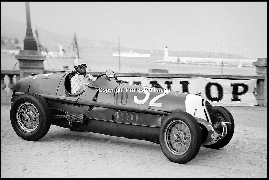 BNPS.co.uk (01202) 558833<br /> Picture: Bonhams/BNPS<br /> <br /> Hans Ruesch at the wheel of the Alfa in the 1937 Monaco GP.<br /> <br /> Historic Alfa Romeo Grand Prix winning racing car sold for a world record £6 million at the Goodwood Revival this weekend.<br /> <br /> The 77 year old Italian machine was designed to take on the might of Hitler's all conquering Mercedes 'Silver Arrows' in the 1930's and bring glory to Mussolini in a sporting battle of the dictators.<br /> <br /> One of the most collectable cars in the world, the magnificent machine, which is in full working order having been restored, won a host of Grand Prix races all over the world before the Second World War. It is being sold by auctioneers Bonhams at its Goodwood Revival sale this Saturday.
