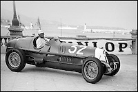 BNPS.co.uk (01202) 558833<br /> Picture: Bonhams/BNPS<br /> <br /> Hans Ruesch at the wheel of the Alfa in the 1937 Monaco GP.<br /> <br /> Historic Alfa Romeo Grand Prix winning racing car sold for a world record &pound;6 million at the Goodwood Revival this weekend.<br /> <br /> The 77 year old Italian machine was designed to take on the might of Hitler's all conquering Mercedes 'Silver Arrows' in the 1930's and bring glory to Mussolini in a sporting battle of the dictators.<br /> <br /> One of the most collectable cars in the world, the magnificent machine, which is in full working order having been restored, won a host of Grand Prix races all over the world before the Second World War. It is being sold by auctioneers Bonhams at its Goodwood Revival sale this Saturday.