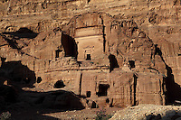 Tomb of Unayshu, late 1st century AD, Petra, Ma'an, Jordan. This tomb carved by the Nabateans in the face of Jabal al-Khubtha, the mountain overlooking Petra on the East and is dedicated to a member of the Nabatean elite. The corner pilaster of the tomb and those flanking the entrance are a typical Nabatean design. The smooth facade is in the same style as the tombs found in Mada'in Saleh, Petra, Jordan Petra was the capital and royal city of the Nabateans, Arabic desert nomads. Picture by Manuel Cohen