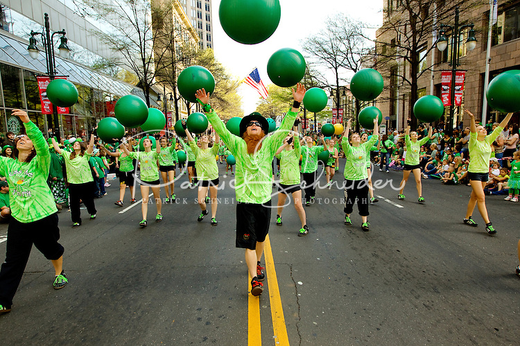 Photography of the Charlotte NC St. Patrick's Day Parade in March 2012. Image shows members of the Acrofitness of Charlotte group performing in the parade along Tryon Street. Photography is part of a series of St. Patrick's Day Parade photos in Charlotte, NC.