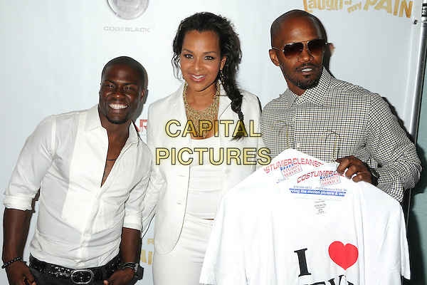 "Kevin Hart, LisaRaye McCoy and Jamie Foxx.Kevin Hart's ""Laugh At My Pain"" Los Angeles Premiere held at the Pacific Design Center, West Hollywood, California, USA..September 7th, 2011.half length check beige grey gray shirt t-shirt holding sunglasses shades heart love white gold necklace .CAP/ADM/BP.©Byron Purvis/AdMedia/Capital Pictures."