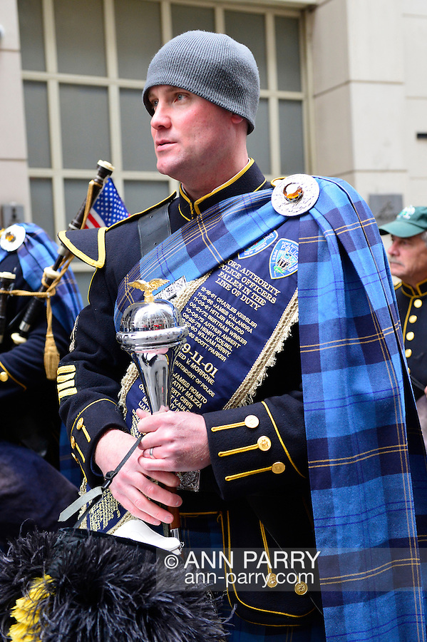 March 16, 2013 - New York, NY, U.S. - At the 252nd annual NYC St. Patrick's Day Parade, thousands of marchers show their Irish pride, as they march up Fifth Avenue, and over a million people, often in green and orange, watch and celebrate. Those marching, many who wore kilts, uniforms, colorful costumes, sashes, included Bag and Pipe Bands; Irish dancers; fire, police, military, religious, educational, and social groups. The sash this band member is wearing lists the names of Port Authority Police Officers killed in the Line of Dutu.