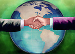 Illustrative image of businessmen shaking hands with globe in the background representing business agreement