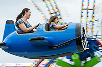 NWA Democrat-Gazette/BEN GOFF @NWABENGOFF<br /> Delandra Cuce and daughter Amelie Cuce, 8, of Centerton take a spin on a ride Thursday, Aug. 8, 2019, during the Benton County Fair in Bentonville.