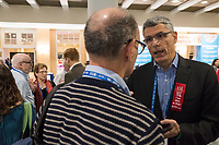 Rabbi Rick Jacobs (tall with red ribbon on lapel) speaks with people attending the Union for Reform Judaism Biennial 2017 in the Hynes Convention Center in Boston, Mass., USA, on Wed., Dec. 6, 2017. Rabbi Jacobs is the president of the Union for Reform Judaism.