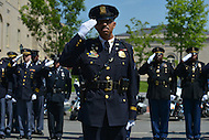 May 10, 2013  (Washington, DC)  Police officers salute the colors during a ceremony at the Washington Area Law Enforcement Memorial for Police Week, May 10, 2013.  (Photo by Don Baxter/Media Images International)