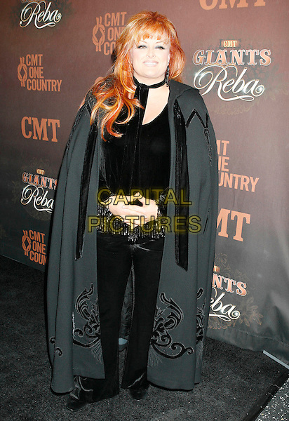 "WYNONNA JUDD.Arrivals at ""CMT Giants"" Honoring Reba McEntire held at the Kodak Theatre, Hollywood, LA, California, USA,.26 October 2006..full length black top cape.Ref: ADM/RE.www.capitalpictures.com.sales@capitalpictures.com.©Russ Elliot/AdMedia/Capital Pictures."