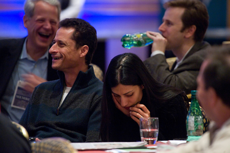 UNITED STATES - JANUARY 21:  Rep. Anthony Weiner, D-N.Y., sits with his wife Huma Abedin before a speech by Vice President Joe Biden on U.S. foreign policy to a gathering of members of Congress during the House Democratic Caucus Issues Conference at the Hyatt Regency Chesapeake Bay in Cambridge, Md.  President Barack Obama is scheduled to speak later in the evening.  (Photo By Tom Williams/Roll Call)