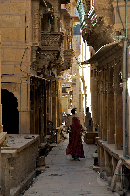 "Jaisalmer the old City and fort.J a i s a l m e r   J a i s a l m e r  n i c k n a m e d   "" T h e   G o l d e n   C i t y "" ,   i s   a   t o w n   i n   t h e   I n d i a n   s t a t e   o f   R a j a s t h a n .   T h e   t o w n   s t a n d s   o n   a   r i d g e   o f   y e l l o w i s h   s a n d s t o n e ,   c r o w n e d   b y   a   f o r t ,   w h i c h   c o n t a i n s   t h e   p a l a c e   a n d   s e v e r a l   o r n a t e   J a i n   t e m p l e s .   M a n y   o f   t h e   h o u s e s   a n d   t e m p l e s   a r e   f i n e l y   s c u l p t u r e d .   I t   l i e s   i n   t h e   h e a r t   o f   t h e   T h a r   D e s e r t   a n d   h a s   a   p o p u l a t i o n   o f   a b o u t   7 8 , 0 0 0 .   I t   i s   t h e   a d m i n i s t r a t i v e   h e a d q u a r t e r s   o f   J a i s a l m e r   D i s t r i c t ....Jaisalmer Fort is one of the largest of desert forts of the world. It is situated in Jaisalmer city in Indian state of Rajasthan. It was built in 1156 AD by the Bhati Rajput ruler Rawal Jaisal, from where it derives it name. The fort stands proudly admist the golden stretches of the great Thar Desert, on Trikuta Hill and had been the scene of many battles. Its massive yellow sandstone walls are a tawny lion color during the day, turning to a magical honey-gold as the sun sets and camouflages the fort making it appear a part of the picturesque yellow desert. Thus, it is also known as the ""Golden Fort"".."