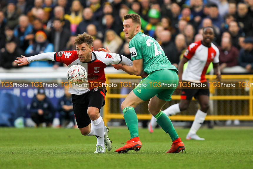 Jake Hyde of Woking and Ben Wilmot of Watford during Woking vs Watford, Emirates FA Cup Football at The Laithwaite Community Stadium on 6th January 2019