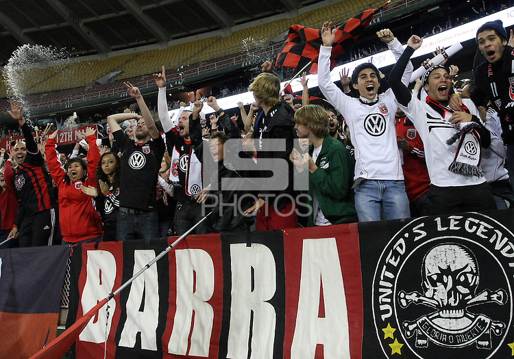 WASHINGTON, DC - OCTOBER 20, 2012:  Fans of D.C United celebrate the win over the Columbus Crew during an MLS match at RFK Stadium in Washington D.C. on October 20. D.C United won 3-2.