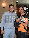 Chairperson of Drogheda Wheelers cycle club Paddy Delaney presents Seamus Howard from Stamullen Road Club with the 2016 Mark Mullen League trophy at the presentation night in The Thatch. Photo:Colin Bell/pressphotos.ie