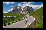 Italy, Dolomites. <br /> Strong lines and color allows you to photograph all day long, not just during the &quot;golden&quot; hours. <br /> Cycling towards Sassolungo in Dolomite Mountains, northern Italy.