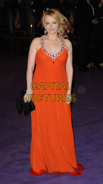 """MIRANDA RICHARDSON.The World Premiere of """"The Young Victoria"""" at the Odeon Leicester Square, London, England. .March 3rd 2009 .full length orange red long maxi dress beaded beads jewelled neckline straps diamond bracelet black clutch bag jewel encrusted rain soaked wet hem trim.CAP/CAN.©Can Nguyen/Capital Pictures."""