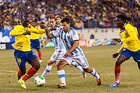 Argentina forward Sergio Aguero (10) is marked by Ecuador midfielder Segundo Castillo (14). Argentina and Ecuador played to a 0-0 tie during an international friendly at MetLife Stadium in East Rutherford, NJ, on November 15, 2013.