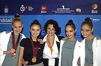 October 19, 2001; Madrid, Spain:  (L-R) Olga Belova, Alina Kabaeva, Irina Viner, Irina Tchachina, Lyasan Utiasheva of Russia smile during press interview portrait after winning team gold at 2001 World Championships at Madrid.
