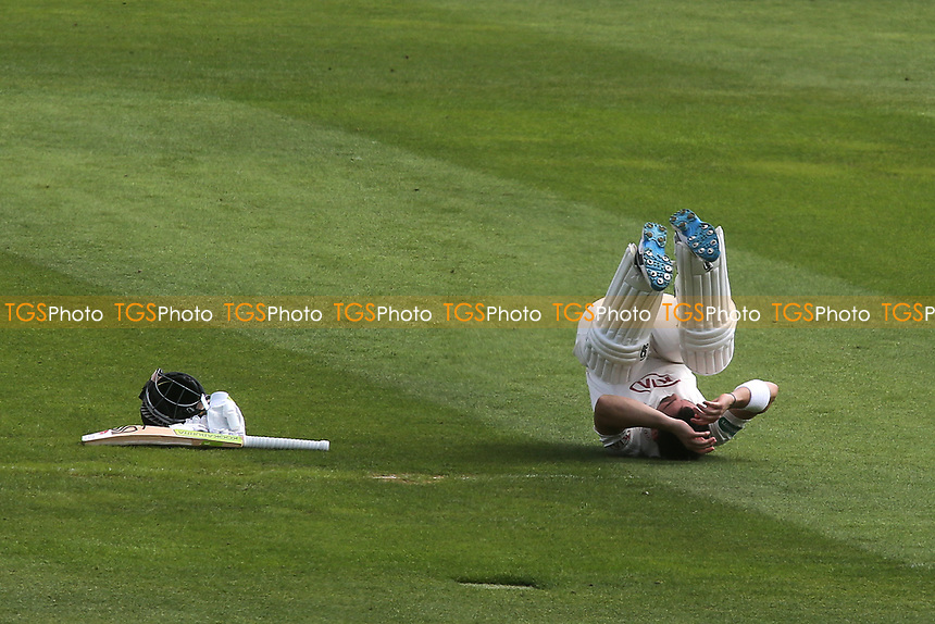 Surrey batsman, Dean Elgar, keeps himself amused while waiting for his next batting partner to join him in the middle during Surrey CCC vs Kent CCC, Specsavers County Championship Division 1 Cricket at the Kia Oval on 7th July 2019