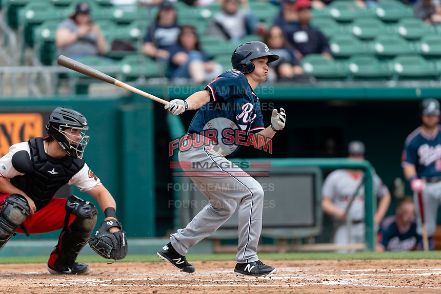 Reno Aces starting pitcher Anthony Vasquez (33) hits an RBI-single during a game against the Fresno Grizzlies at Chukchansi Park on April 8, 2019 in Fresno, California. Fresno defeated Reno 7-6. (Zachary Lucy/Four Seam Images)