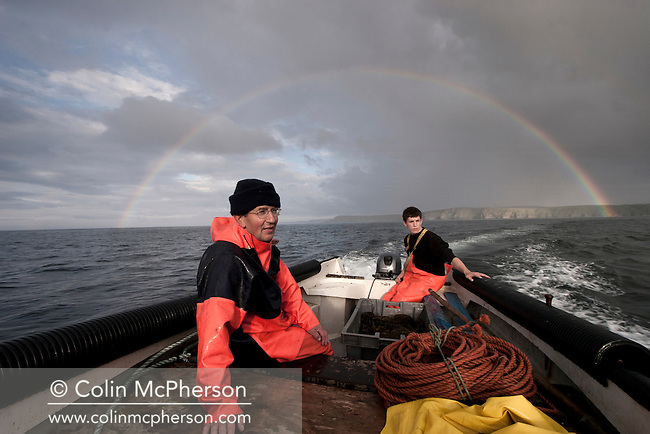 Simon Paterson and his son James setting out in their boat at Strathy in the far north of Scotland to fish their bag nets for wild Atlantic salmon. Mr Paterson, a third-generation salmon fisherman whose family has worked in Sutherland for over 40 years, has been told that this season is to be his last as the government has decided not to renew his lease on the only publicly-owned fishery in Scotland. The Strathy fishery also doubles as the UK's only scientific monitoring station of the stocks of wild salmon and sea trout.