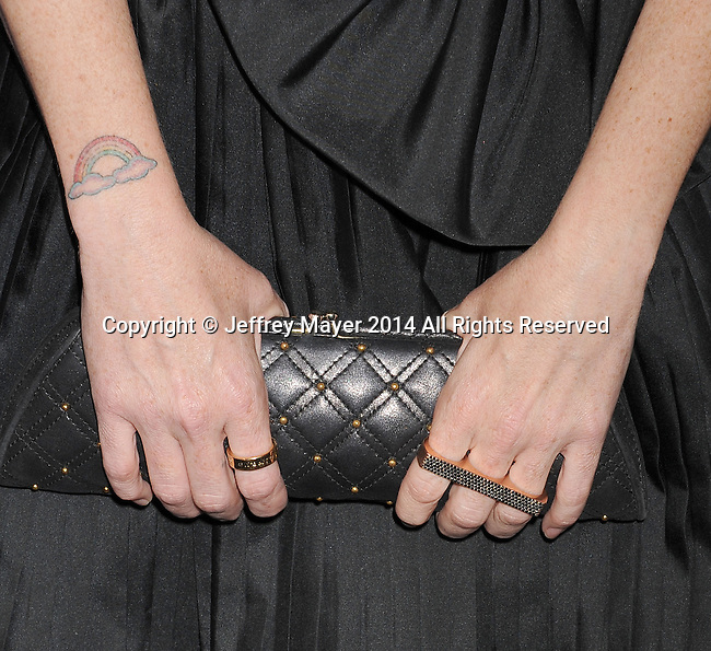 LOS ANGELES, CA- AUGUST 21: Actress Taryn Manning (handbag, tattoo detail) at the Audi Emmy Week Celebration at Cecconi's Restaurant on August 21, 2014 in Los Angeles, California.