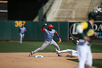 """OAKLAND, CA - AUGUST 26:  Elvis Andrus #1 of the Texas Rangers turns a double play at second base against the Oakland Athletics during the game at the Oakland Coliseum on Saturday, August 26, 2017 in Oakland, California. Note: both teams are wearing special colorful uniforms for """"Players Weekend"""" that also include nicknames on the backs of their jerseys. (Photo by Brad Mangin)"""