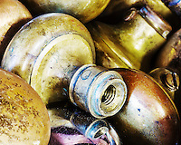 Vintage door knobs stacked in bin.
