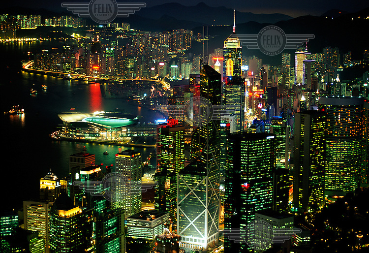 Lights and skyscrapers of Hong Kong seen from the Peak. Bank of China building in foreground, and the Convention Centre jutting out into Hong Kong harbour at left. .