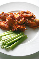 Buffalo Chicken Wings and Cute Celery Stalks on a Plate. Photography by Andrew Thomas Clifton